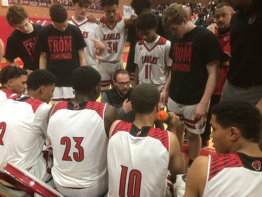 Ironwood basketball coach Jordan Augustine talks to his team during a game on Jan. 14, 2020.