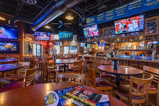 The interior of The Moon Saloon sports bar.