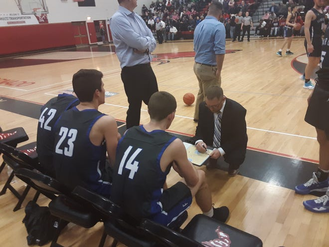 Cedar Crest coach Tom Smith gets in some last-minute instructions prior to the start of the third quarter Tuesday night.