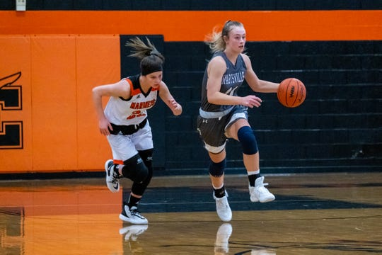 Marine City's Khloe Austin (left) chases Marysville's Gabby Fogarty as she runs with the ball during their game Tuesday, Jan. 14, 2020, at Marine City High School.