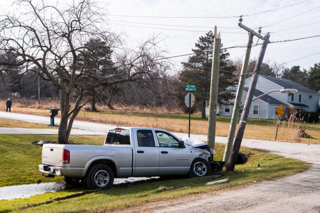 West Water Street in Port Huron Township is closed after a truck hit a utility pole Wednesday, Jan. 15, 2020. DTE expects the road to remain closed for several hours while repairs are made.