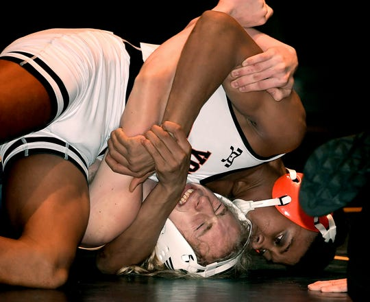 York Suburban's Kenny Johnson, top, battles Eastern York's Brock Bolton in a 160-pound match at Eastern York Tuesday, January 14, 2020. Johnson won with a pin. Bill Kalina photo