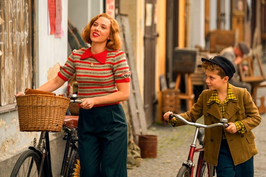 """Scarlett Johansson, left, and Roman Griffin Davis are seen in the WWII satirical film """"Jojo Rabbit."""" The movie opens Friday at Regal West Manchester."""