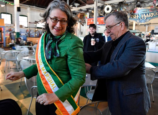Former parade Grand Marshal Mary Yeaple gets a bit of help with her sash from fellow former Grand Marshal, and husband, Rodney, Wednesday, January 15, 2020. John A. Pavoncello photo