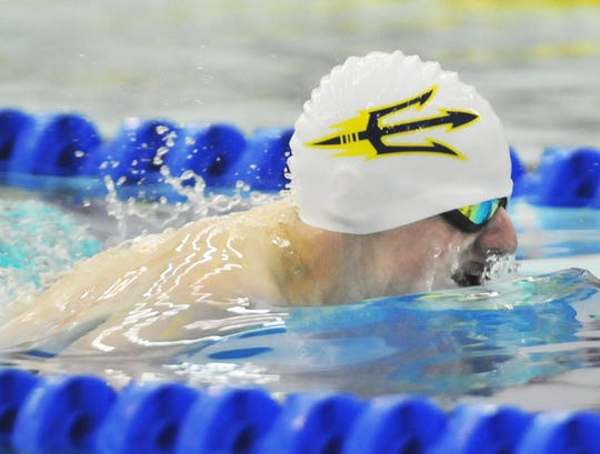 Alex Crossing of Victor swims the breaststroke during his win against Fairport in the 200-yard individual medley on Tuesday