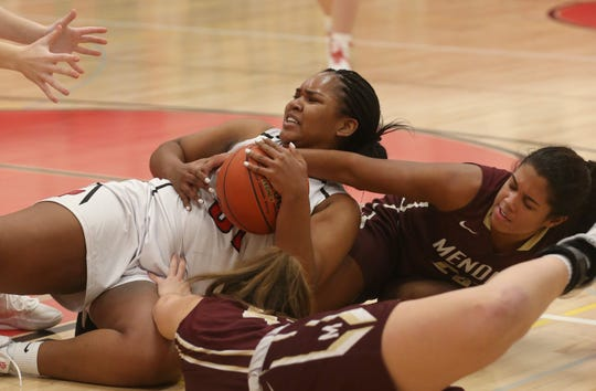 Penfield's Nyara Simmons, left, battles for a loose ball with Mendon's Lexi Green, right, and Bridget Miller, bottom.