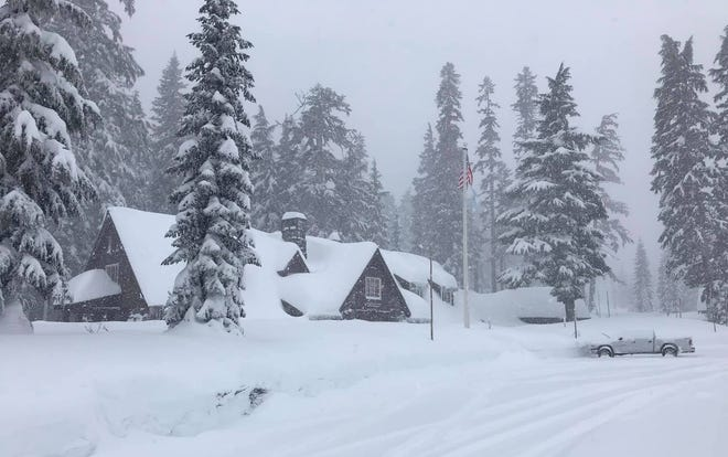 Snowfall at Crater Lake National Park headquarters on Monday, Jan. 13.