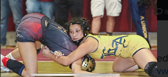 Everett Alvarez wrestler Kaelyn Siason took home first in her weight class at the inaugural PCAL girls' wrestling tournament.