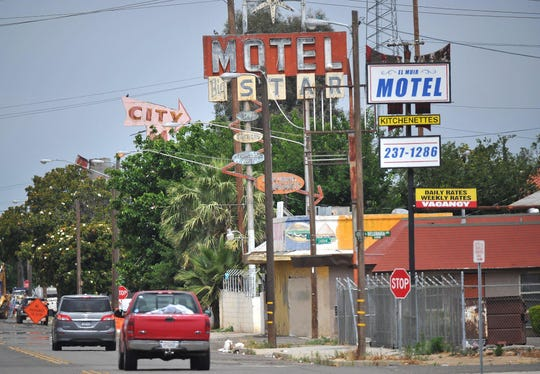 Old motels along Golden State Boulevard with decades old signage. Photo for use with CalMatters