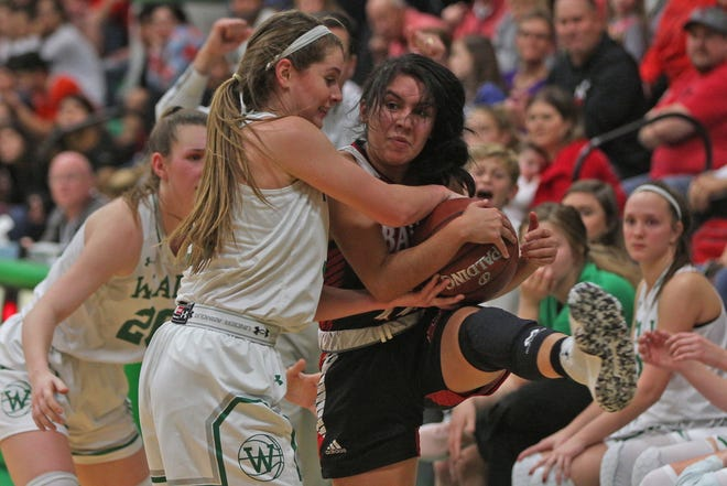 Cynthia Camarillo, right, battles for control of the ball for Ballinger as Kylie Phillips, left, tries to steal for Wall on Tuesday, Jan. 14, 2020.