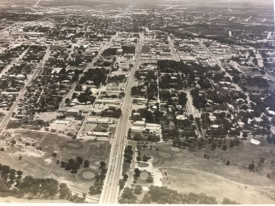 Santa Fe Park in San Angelo is seen from the air in this photograph from 1964. The old wading pond on Santa Fe Park Drive between Twohig and Concho avenues can be seen, and Lamar Elementary, originally the West Ward School, is still standing.
