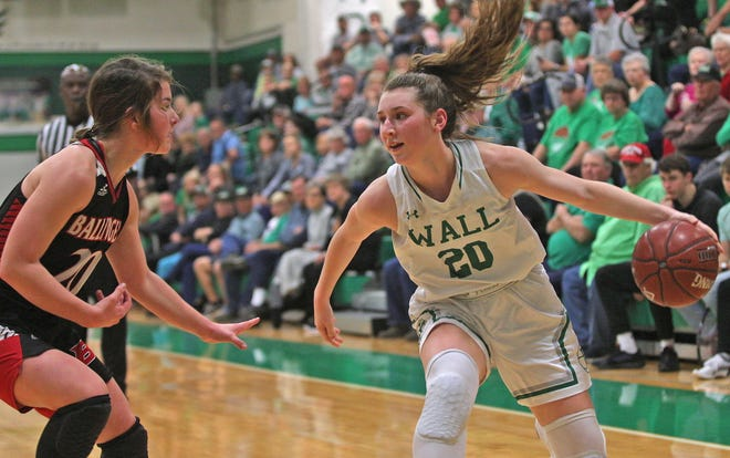 Wall High School's Landry Reynolds, right, tries to make her way around Ballinger's Jenna Battle, left, during a District 4-3A girls basketball game Tuesday, Jan. 14, 2020 in Wall.