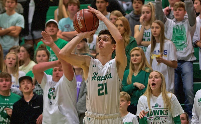 Austin Williams takes a shot for Wall during a game against Ballinger on Tuesday, Jan. 14, 2020.