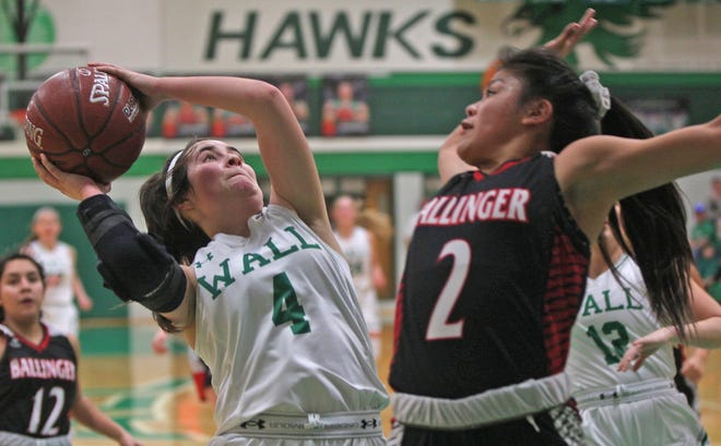 Candra Barnett, left, drives to the basket for Wall during a game against Ballinger on Tuesday, Jan. 14, 2020.
