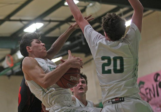 Drew Morrison, left, pulls down a rebound for Wall during a game against Ballinger on Tuesday, Jan. 14, 2020.