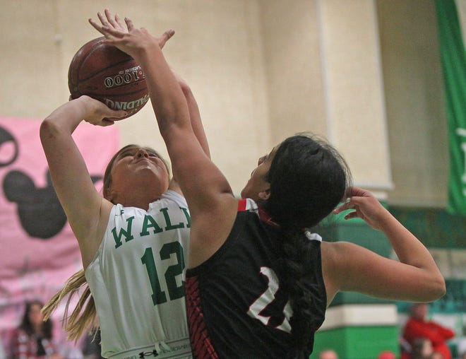 Candace Welch, left, drives toward the basket for Wall during a game against Ballinger on Tuesday, Jan. 14, 2020.