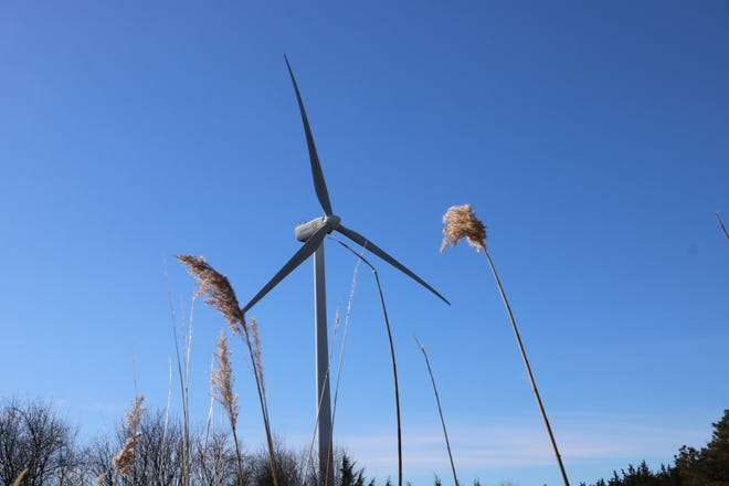 A two-megawatt turbines spins in the breeze by the University of Delaware's campus in Lewes. The wind turbine is less than half the size of the larger 12-megawatt wind turbine Orsted plans to use off the coast of Delaware for its Skipjack Wind Farm project.