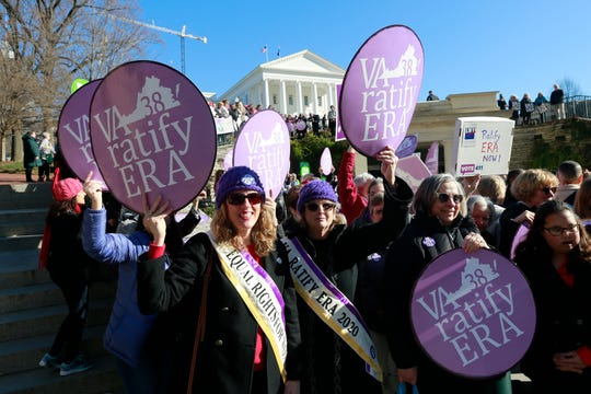 In this Wednesday, Jan. 8, 2020, file photo, Equal Rights Amendment supporters demonstrate outside Virginia State Capitol in Richmond.