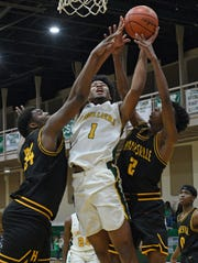 Calvary's D'Marcus Hall drives to the hoop in traffic against Haynesville in a conference game Tuesday at Calvary.