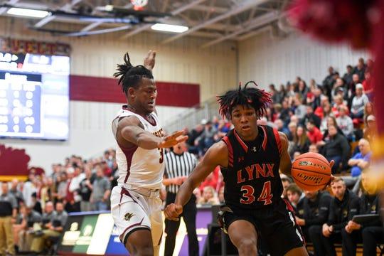 Brandon Valley's Jackson Hilton (34) dribbles toward the basket as Roosevelt's Tyler Feldkamp (3) guards on Tuesday, Jan. 14, 2020 at Roosevelt High School.
