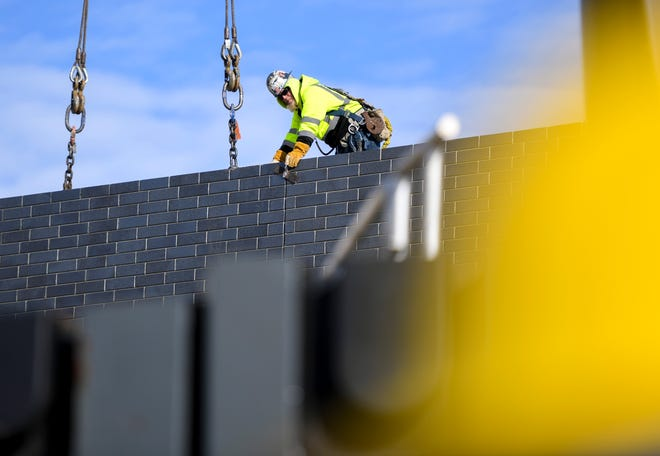 Construction crews work on the new Jefferson High School on Tuesday, Jan. 7, 2020 at the site near North Marion Road and Career Avenue.