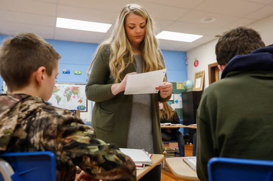 Tiffany Gladden, a teacher with the Everton School District, checks students' work on a math assignment during class on Tuesday.