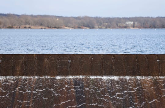 Water flows into the spillway at the Fellows Lake dam on Tuesday. Recent rains have filled the reservoir, which supplies water to Springfield, to capacity.