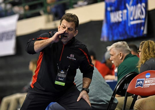 St. Cloud State wrestling head coach Steve Costanzo yells instructions Friday, Mar. 8, 2019, at the NCAA DII Championships in Cleveland.