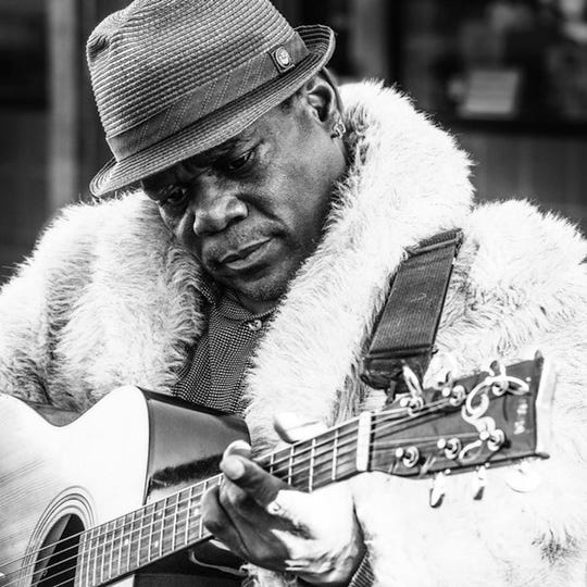 J.J. Rolle bring his guitar to Blue Tavern on Tuesday.