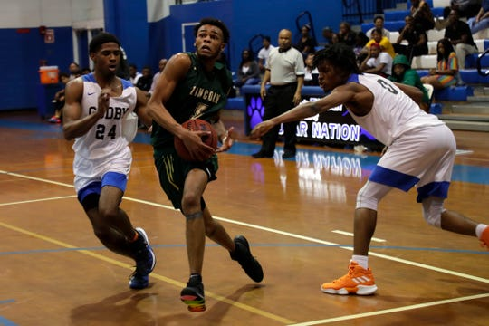 Lincoln junior forward David Gainous drives to the basket as Lincoln's boys basketball team beat Godby 68-60 on Jan. 14, 2020.