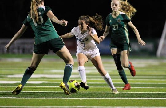 Maclay senior Hannah Hosay splits two defenders as Maclay's girls soccer team beat Lincoln 2-1 at Chiles High on Jan. 14, 2020
