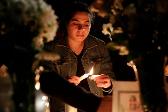 Aida Rahimi lights a candle to honor the victims of the plane crash of Flight PS 752. The vigil was hosted by the Iranian Student Organization at Florida State University on Tuesday, Jan. 14, 2020.
