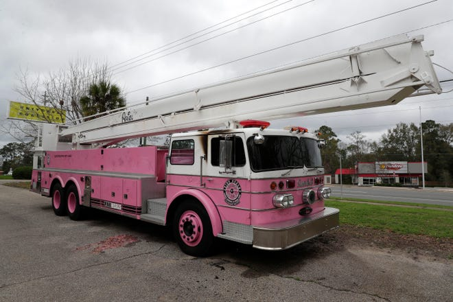 The pink fire truck that sits in front of Universal Collision on Appalachee Parkway was set ablaze Tuesday night, Jan. 14, 2020. The incident is suspected to be caused by an arsonist. The truck was named 'Ariel' in honor of a teenage girl who died of liver cancer at age 18, roughly two years after she was diagnosed.
