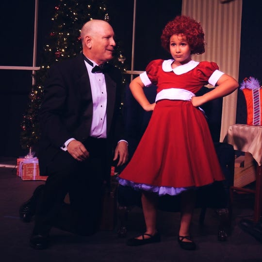 """Isabella Hanselman (Annie) Jack Peacock (Warbucks) in the lNext Step Performing Arts Studio production of """"Annie."""""""