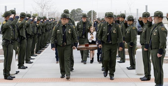 Border Patrol agents carry the cremains of Border Patrol Tactical Unit K-9 Bulder, who was memorialized Wednesday, Jan. 15, 2020, at Abundant Living Faith Center West Campus, 7100 Desert Blvd. N., in El Paso. Bulder was shot and killed while helping serve arrest and search warrants Dec. 17, 2019, at a suspect's home in Northeast El Paso.