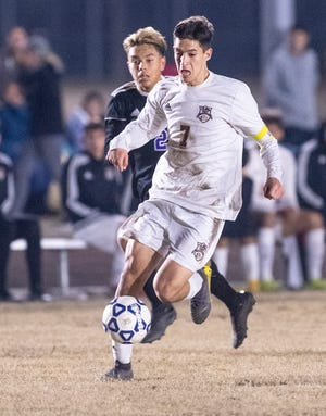 Tulare Union's Jesus Enriquez advances ahead of Mission Oak's Nathan Mata  in a boys soccer match on Tuesday, January 14, 2020.