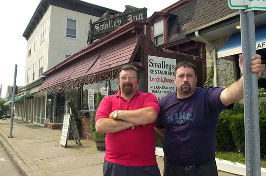 Anthony Porto (left) and his son Tony Porto (right) outside Smalley's Inn on Rt 52 in Carmel in August 2002.