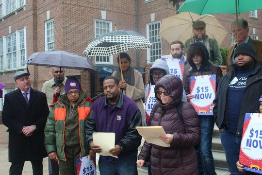 Union members rally on the steps of the Capitol Tuesday for a $15 an hour minimum wage in Delaware.