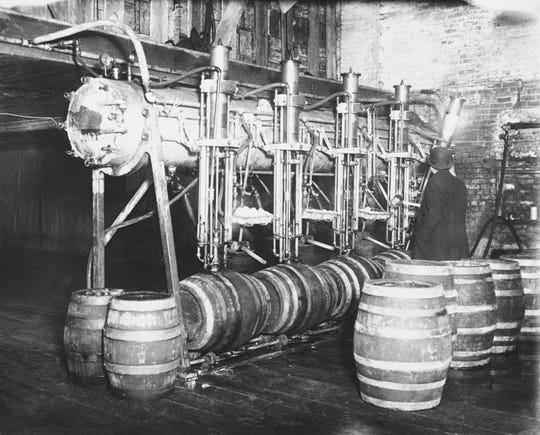 FILE - In this March 21, 1931, file photo dry agents seize 7,000 barrels of beer in Newark raid, Calif. Prohibition greatly expanded federal law enforcement powers and turned millions of Americans into scofflaws. It provided a new revenue stream for organized crime. (AP Photo, File)