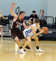 Seymour's Caden Gilbreath defends Windthorst's Max Owen in a District 9-2A game in Windthorst Tuesday, Jan. 14, 2020.