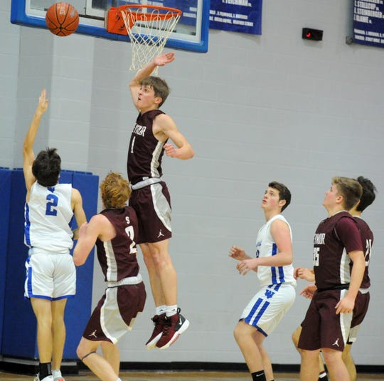 Seymour's Cody Fite (1) attempts to block a layup by Windthorst's Max Owen in District 9-2A action in Windthorst Tuesday, Jan. 14, 2020.