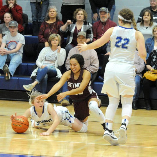 Seymour's Fernanda Garcia battles for a loose ball with Windthorst's Camryn Latham during a District 9-2A game in Windthorst Tuesday, Jan. 14, 2020.