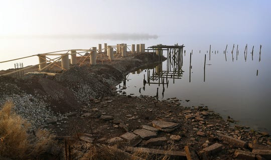 The new pier under construction at Lake Wichita will extend 160 feet and is being built adjacent to the pilings of the original fishing pier and 3-story pavilion from 1912. The pavilion was destroyed by fire in 1955.