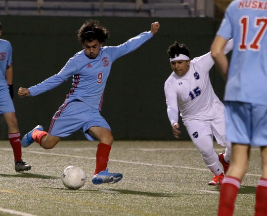 Hirschi's Jose Gutierrez attempts a shot on the Lubbock Estacado goal Tuesday, Jan. 14, 2020, at Memorial Stadium.