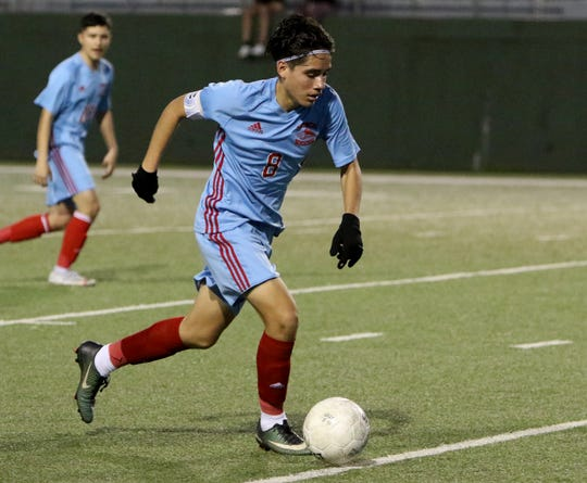 Hirschi's Bryan Camacho dribbles in the game against Lubbock Estacado Tuesday, Jan. 14, 2020, at Memorial Stadium.