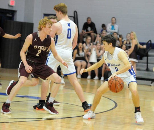 Seymour's Nick Slaggle defends Windthorst's Max Owen in a District 9-2A game in Windthorst Tuesday, Jan. 14, 2020.