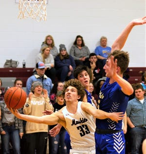 Evan Williams (33) aims for the basket while Philo's AJ Clayton (1) attempts to block in Tuesday's game. The Muskies won 50-35.
