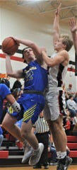 Maysville's Adam Armstead goes up for a shot against Crooksville's Caden Sparks in Tuesday's game. The Panthers won 69-65.