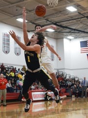 Sheridan's Shay Taylor blocks the shot of Tri-Valley's Ty Smith on Tuesday night in Thornville.