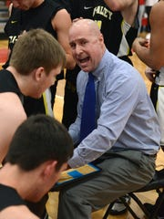 Tri-Valley coach Todd McLoughlin offers some encouragement to his players during a win against Sheridan in Thornville. The Scotties earned the No. 3 seed at their Division II sectional tournament drawing.